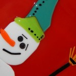 fused glass red plate featuring a snowman