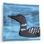fused glass dish featuring a loon