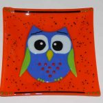 fused glass dish featuring an owl