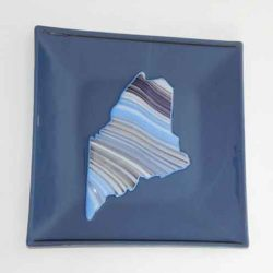 Fused glasss dish with the shape of the State of Maine in the center