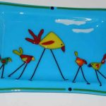 dish featuring a family of struttin' birds