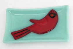 fused glass dish featuring a cardinal
